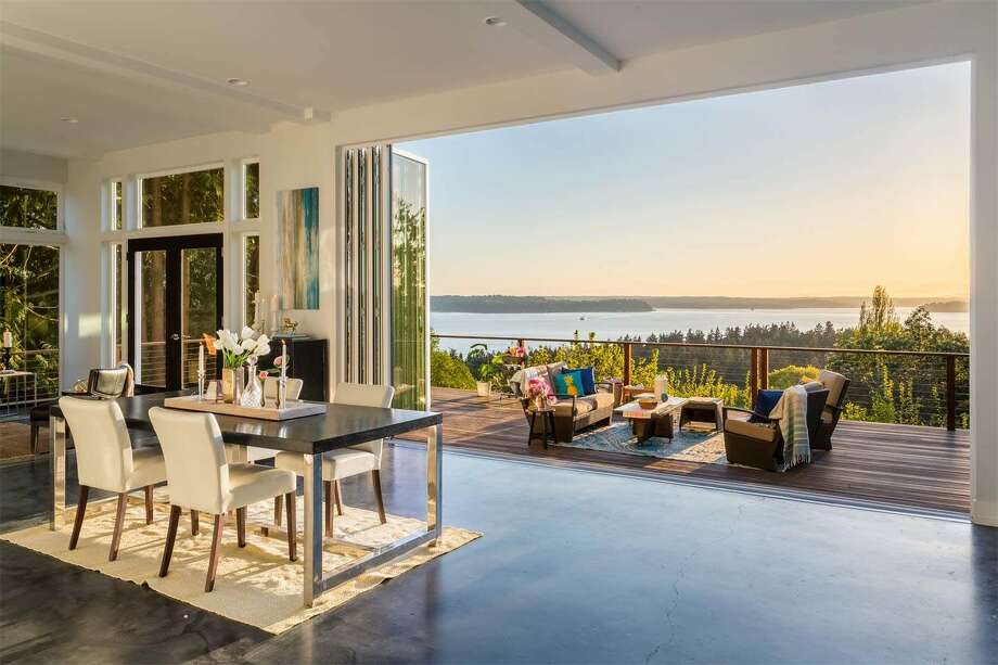 This home in south West Seattle,7931 California Ave. S.W., is listed for$1.395 million. The three bedroom, 2.5 bathroom home spans more than 3,700 square feet and includes a giant 1,000 square-foot deck. The home has west-facing island and water views.You can see the full listing here. Photo: Courtesy Of Realogics Sotheby's International Realty / Courtesy of Realogics Sotheby's International Realty