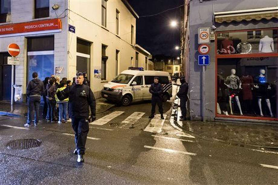 In this Tuesday, Nov. 17, 2015, file photo, police guard a street in which special intervention forces searched a house in the Molenbeek neighborhood in Brussels. Molenbeek is separated from the Midi section of Brussels by part of a mosaic of jurisdictions of 19 municipalities andsix policing zones, all for a population ofone million, long hampering cooperation. (AP Photo/Geert Vanden Wijngaert)
