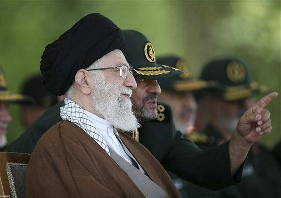 In this file picture released by the official website of the office of the Iranian supreme leader on Wednesday, May 20, 2015, Supreme Leader Ayatollah Ali Khamenei listens to Revolutionary Guard commander Mohammad Ali Jafari during a graduation ceremony of a group of the guard's officers in Tehran, Iran. (Office of the Iranian Supreme Leader via AP, File)