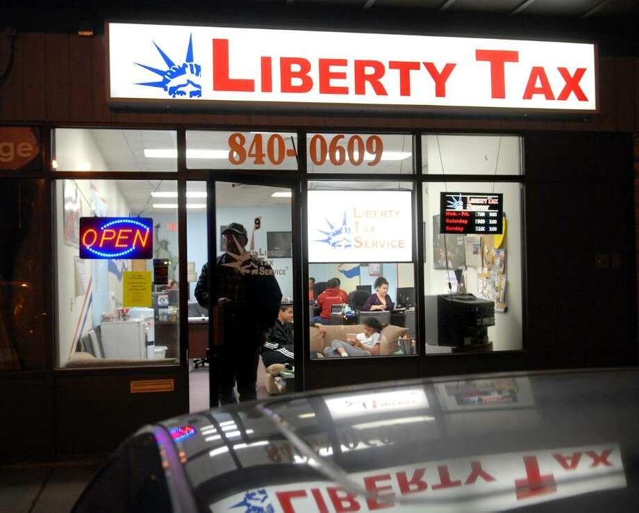 Exterior of Liberty Tax Service, 304 Main Ave., Norwalk, Conn., late Tuesday evening, April 13, 2010, two days before the tax filing deadline. Photo: Bob Luckey / Greenwich Time