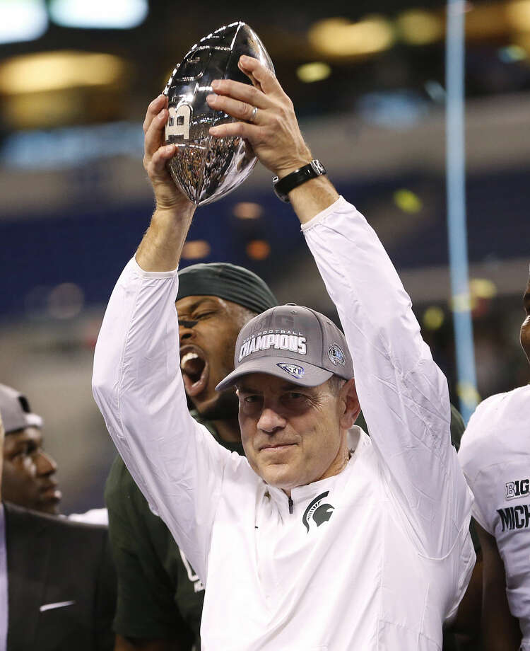 Michigan State coach Mark Dantonio holds the trophy after Michigan State defeated Iowa 16-13 to win the Big Ten championship NCAA college football game Saturday, Dec. 5, 2015, in Indianapolis. (AP Photo/AJ Mast) Photo: AJ Mast