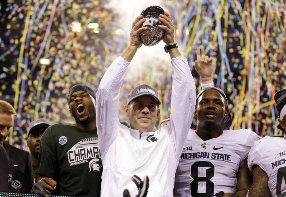 Michigan State coach Mark Dantonio holds the trophy after Michigan State defeated Iowa 16-13 in the Big Ten championship NCAA college football game Saturday, Dec. 5, 2015, in Indianapolis. (AP Photo/Michael Conroy) Photo: Michael Conroy
