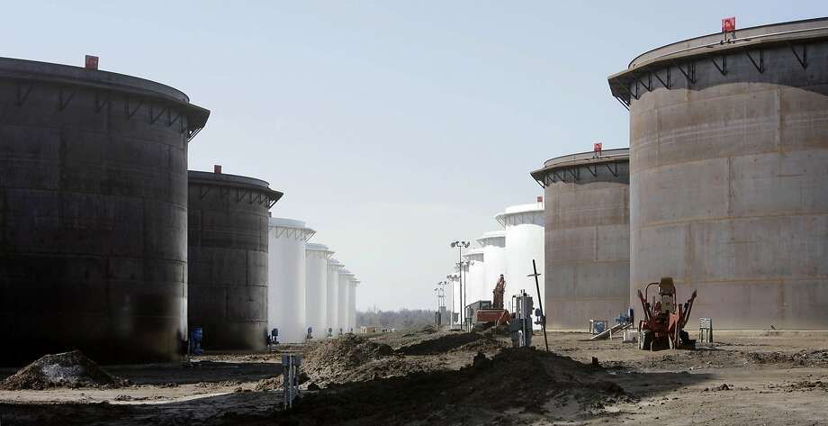 This March 13, 2012 photo shows older and newly constructed 250,000 barrel capacity oil storage tanks at the SemCrude tank farm north of Cushing, Okla. Photo: Michael Wyke, Associated Press