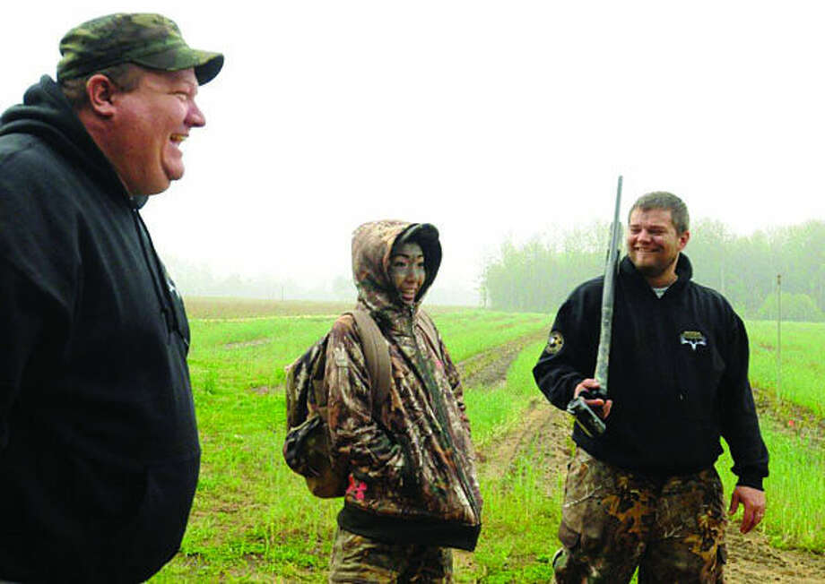 Michigan Outdoor Heritage Foundation's Ben Terpstra and Bill Zawilla talk with Caitlin Sall during her turkey hunt with the Michigan Outdoor Heritage Foundation last spring. Sall has been through plenty in her life to limit her, but she is certain it won't slow her down. After being diagnosed with a cancer called synovial sarcoma in 2012, Sall received eight rounds of chemotherapy and 31 rounds of radiation at Helen DeVos Children's Hospital over the course of 10 months and was declared in remission in the spring of 2013. (Cory Olsen/The Grand Rapids Press via AP) Photo: Cory Olsen