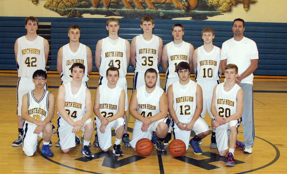 Members of the North Huron varsity boys basketball team are (front row from left) Stefan Wang, Ray Heins, Trent Popour, Justin Baranski, Matt Koth and Justin Whelan (back row) Nick Schramski, Brandon Berry, Wade Pettit, Brendan Breuss, Connor Kowaleski, Noha Polega and coach Bill McLellan Jr. Missing is Adam Pechette.