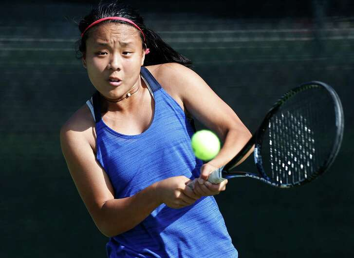 New Braunfels High School's Sammi Gillas (pictured) returns a backhand against Johnson's Chuyang Guan during the girls singles finals match at the Region IV-6A tennis tournament at McFarlin Tennis Center on Wednesday, April 20, 2016. Gilles earned a berth to the state tournament with a win over Guan, 6-3, 6-1.