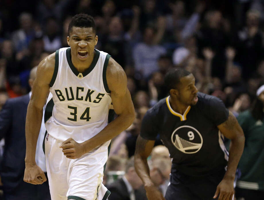 Milwaukee Bucks' Giannis Antetokounmpo (34) reacts after a made shot during the first half of an NBA basketball game against the Golden State Warriors Saturday, Dec. 12, 2015, in Milwaukee. (AP Photo/Aaron Gash) Photo: Aaron Gash
