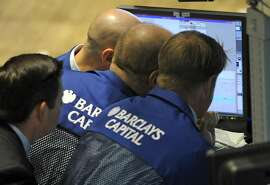 In this May 6, 2010 file photo, traders from Barclays Capital work on the floor of the New York Stock Exchange, in New York. Using super-fast computers, high-frequency traders in effect bend down to pick up pennies lying about in the stock market, then do it again, sometimes thousands of times a second. (AP Photo/Henny Ray Abrams, File)
