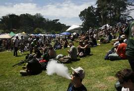 Ian Lines uses a vaporizer to smoke during the annual 4/20 celebration in Golden Gate Park's Sharon Meadow April 20, 2016 in San Francisco, Calif.