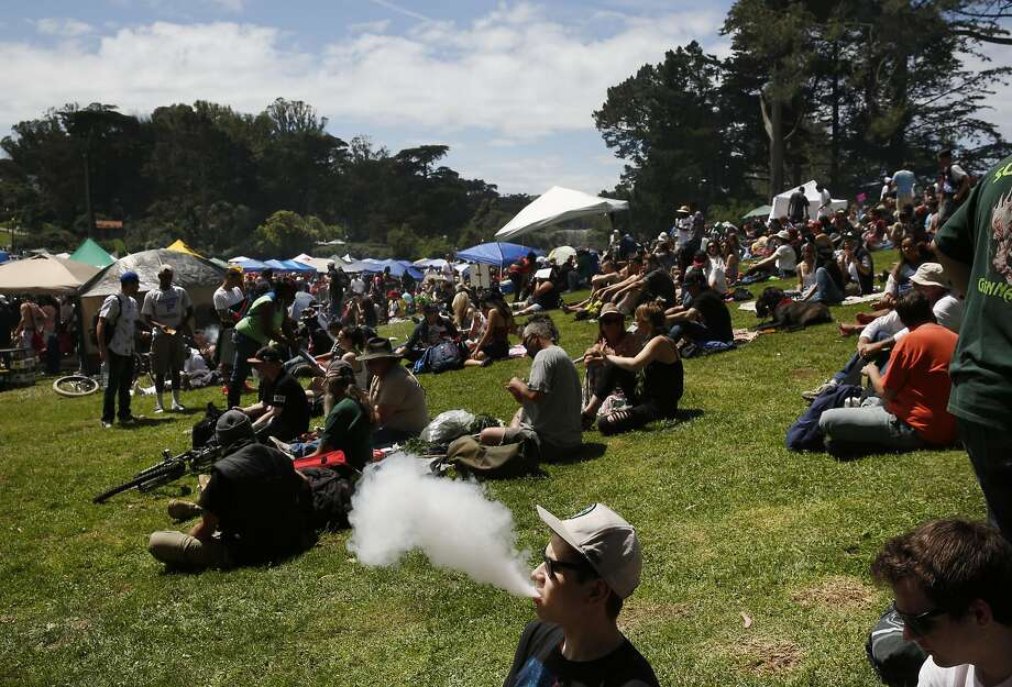 Ian Lines uses a vaporizer to smoke during the annual 4/20 celebration in Golden Gate Park's Sharon Meadow April 20, 2016 in San Francisco, Calif. Photo: Leah Millis, The Chronicle