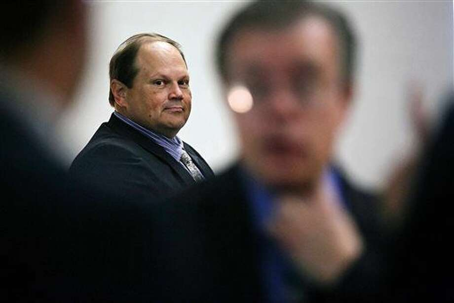 In this July 15, 2015 file photo, Eddie Tipton looks over at his lawyers before the start of his trial in Des Moines, Iowa. The former security director of the Multi-State Lottery Association, accused of tampering with lottery drawings to rig jackpots in four states, was convicted of fraud in the attempt to claim a $16.5 million jackpot in Iowa. (Brian Powers/The Des Moines Register)