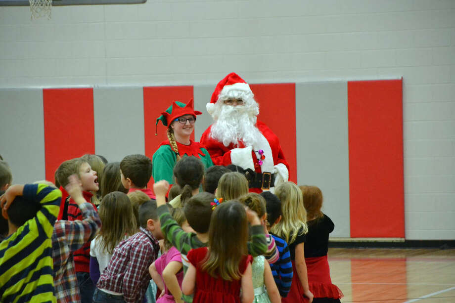 2a149d5422d Students run up to Santa Claus during a visit he made this week to Owen-