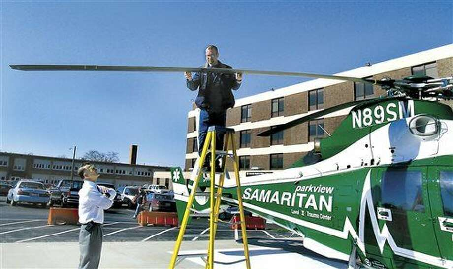 In this Wednesday, April 14, 2004, file photo, Parkview Samaritan helicopter pilot Brad Wilson checks the rotor blade for damage after being struck by a bird while flying, just one mile from Community Hospitals of Williams County, in Bryan, Ohio, the destination landing pad to transport a patient. Reports of helicopter bird strikes are up dramatically in recent years, including incidents that damage the aircraft and create the potential for crashes, according to the Federal Aviation Administration. In 2013, there were 204 reported helicopter bird strikes, a 68 percent increase from 2009 when there were 121 reports and an increase of over 700 percent since the early 2000s, said Gary Roach, an FAA helicopter safety engineer. (Carla Allshouse/The Bryan Times via AP)