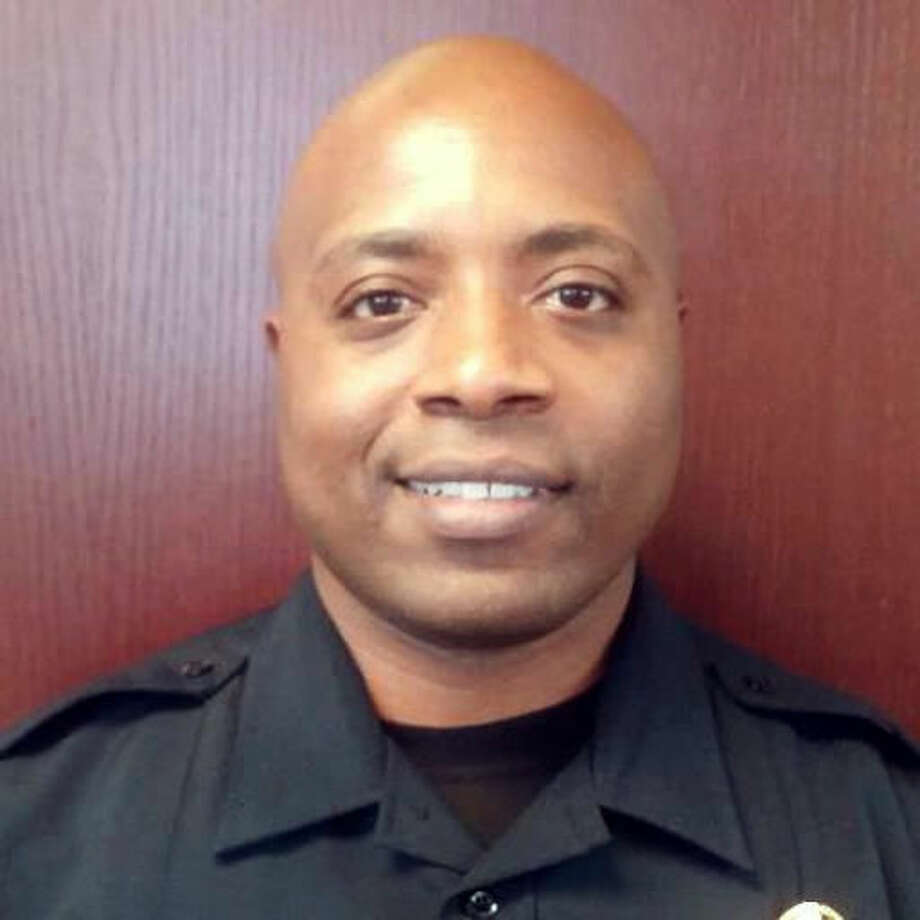 This undated handout photo provided by the Farmers Branch Police Department shows Ken Johnson. Authorities say a 16-year-old from Dallas has been killed and another person is hospitalized after a shooting at a gas station involving an off-duty suburban Dallas police officer. An Addison, Texas spokesman says the preliminary investigation suggests Johnson intervened when he saw a crime in progress. (Farmers Branch Police Department via AP) Photo: HOGP