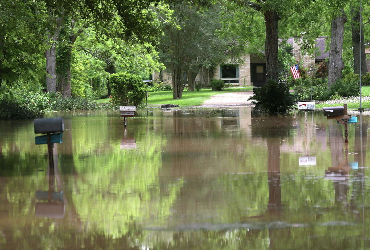 Mailboxes pop out of the flooded waters near Strange and Greenwood Roads in Richmond, Texas where the Brazos River is expected to continue to rise. Photos of flooding in Fort Bend County outside of Houston, Texas on Wednesday, April 20, 2016, in Richmond.