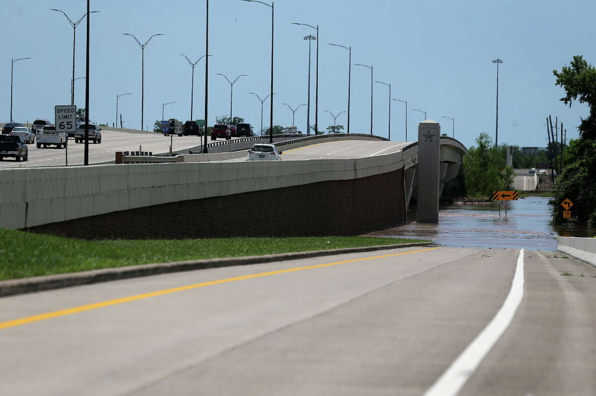 An off ramp on 59 South is blocked by overflow from the Brazos River in Sugarland, Texas on Wednesday, April 20, 2016, in Richmond.