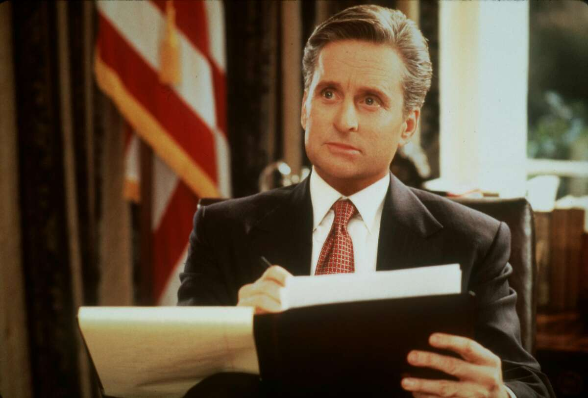 FILE--Michael Douglas, shown in this undated file photo, stared as the widowed president Andrew Shepherd in the 1995 film 'The American President.' Life in the White House has been a hot topic for films during the Bill Clinton years. (AP Photo/Castle Rock Entertainment) HOUCHRON CAPTION (11/02/2000): MICHAEL DOUGLAS STRIKES A PENSIVE POSE AS PRESIDENT.