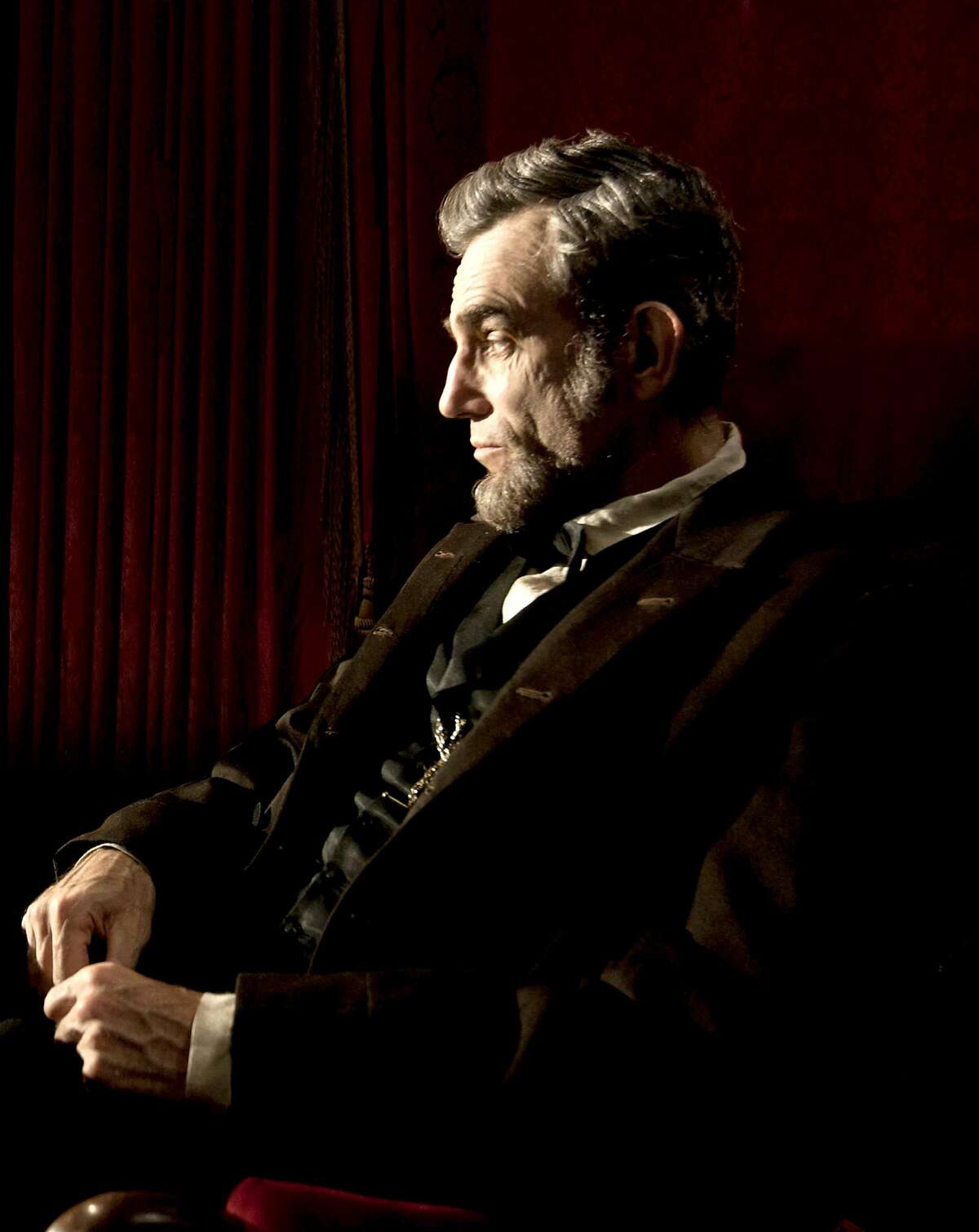 """This publicity film image released by DreamWorks and Twentieth Century Fox shows Daniel Day-Lewis portraying Abraham Lincoln in the film """"Lincoln."""" Not everybody in our mini-poll voted for the star as Best Actor - but almost everybody did."""