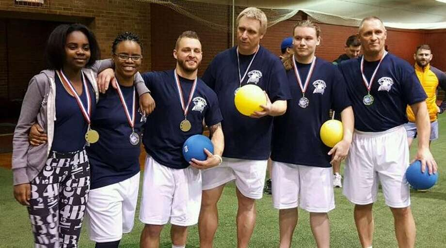 The co-ed team gold medalists at the Empire State Corporate Challenge dodgeball tournament at the Schenectady Armory last weekend. (Courtesy Anthony Mills)  ORG XMIT: Clj_M15lvwfWswuBcuBL
