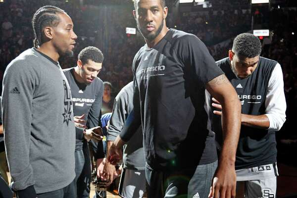 San Antonio Spurs' Kawhi Leonard (from left), Danny Green, Tony Parker, LaMarcus Aldridge, and Tim Duncan huddle before Game 1 in the first round of the Western Conference playoffs against the Memphis Grizzlies Sunday April 17, 2016 at the AT&T Center.