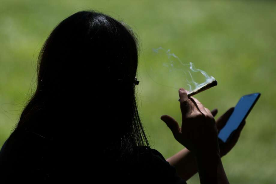 A woman smokes a joint. Photo: GRANT HINDSLEY, SEATTLEPI.COM