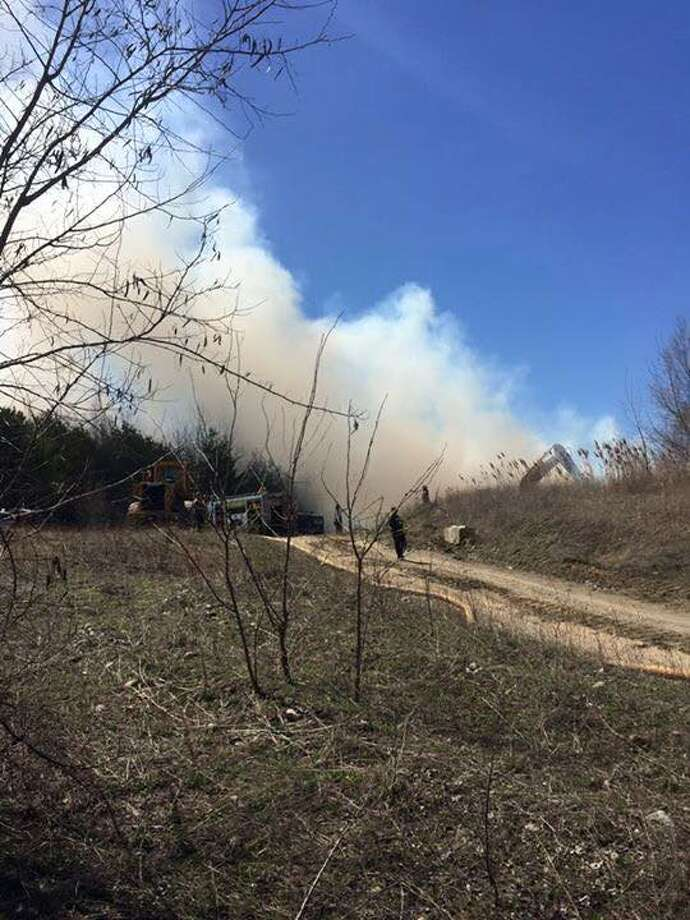 Firefighters spent several hours Wednesday, April 20, 2016, fighting a brush fire made up of a large leaf pile at the Warren W. Fane, Inc. gravel pit. (Wynantskill Fire Department Facebook page) ORG XMIT: btJl_z-W9F-aWdMN9r5V