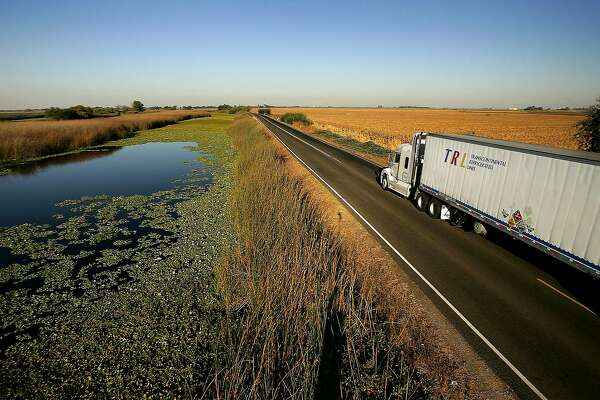 STOCKTON, CA - SEPTEMBER 28:  Water is held back from a lower-elevation farm (R) by a section of Highway 4 that serves as a levee road in the Sacramento-San Joaquin River Delta, on September 28, 2005 west of Stockton, California. Officials say that the dikes of the Sacramento-San Joaquin River Delta are in worse shape than those that broke and flooded New Orleans during Hurricane Katrina. There is a two-in-three chance that a catastrophic earthquake or storm in the next 50 years will damage the levees enough to cause the kind destruction that engulfed New Orleans, according to experts. Such an event would affect the water supply that serves two-thirds of California and create a nightmare traffic jam on Highway 4, the two-lane road that would be the major evacuation route, if it is not damaged beyond usability. 1,600 miles of levees protect the delta?s islands, which lie well below sea-level, and most were built more than 100 years ago.  (Photo by David McNew/Getty Images)