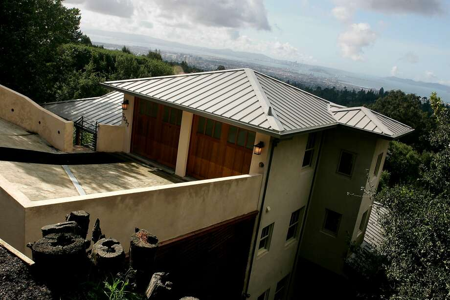 FILE -  A view of both the Bay Bridge and Golden Gate can bee seen from the Japanese inspired home with eco-friendly elements on Skyline Blvd., in the Montclair neighborhood of Oakland in 2007. Photo: Kat Wade/The Chronicle, SFC