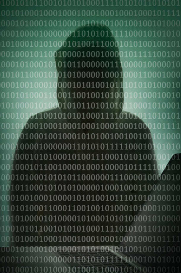 Binary code and hacker over a laptop Photo: Buena Vista Images / (c) Buena Vista Images