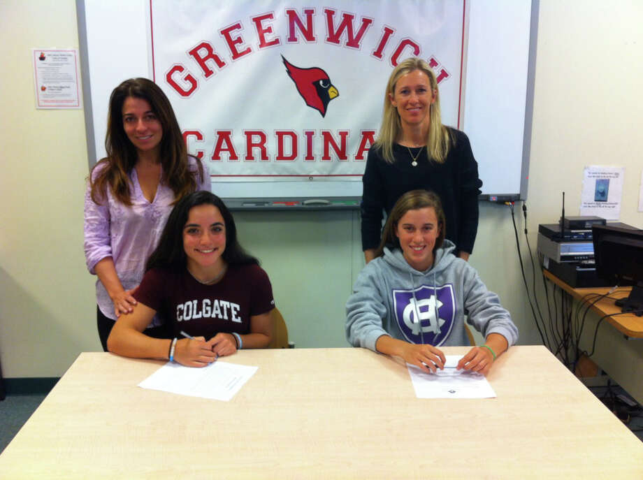 Seated from left, seniors Jenna Restieri and Caroline Frey each signed National Letters of Intent during a ceremony at Greenwich High on Wednesday. Restieri will continue her track and field career at Colgate University. Frey will compete in track and field at School of the Holy Cross. Behind Restieri is her mother, Nina. Frey is joined by her mother, Melissa Photo: Contributed / Contributed Photo / David Fierro/Hearst Connecticut Media