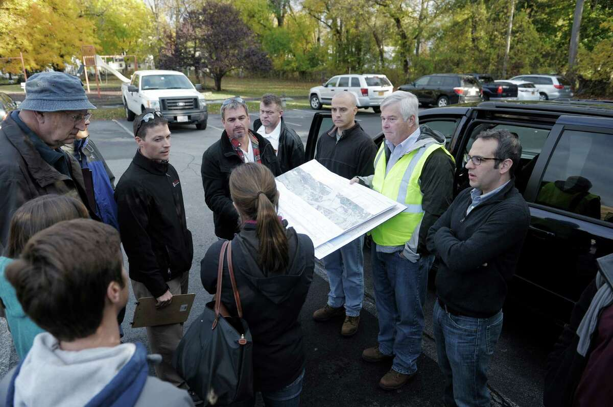 James Flynn, second from right, a project manager with Kinder Morgan, holds a map showing the company's gas pipelines for Federal Energy Regulatory Commission staff and representatives from the Town of Bethlehem on Thursday, Oct. 30, 2014, in Bethlehem, N.Y. Kinder Morgan is proposing to add a third pipe to a portion of the Tennessee Gas Pipeline. (Paul Buckowski / Times Union)