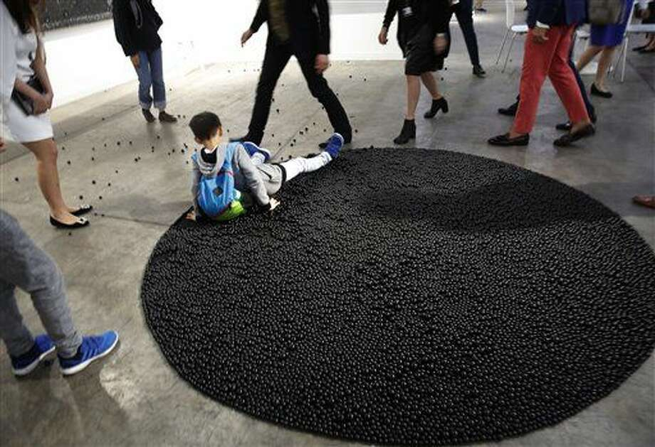"Houston visitors will see but not be able to step on Mona Hatoum's ""Turbulence (black)."" At Art Basel in Hong Kong in March, a boy slipped on the installation. Photo: Kin Cheung"