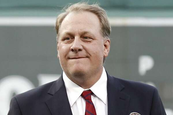 FILE - In this Aug. 3, 2012, file photo, former Boston Red Sox pitcher Curt Schilling looks on after being introduced as a new member of the Boston Red Sox Hall of Fame before a baseball game between the Red Sox and the Minnesota Twins at Fenway Park in Boston. Schilling is defending himself after making comments on social media about transgender people, saying he was expressing his opinion. (AP Photo/Winslow Townson, File)