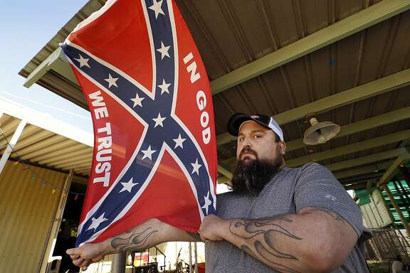 Charles Leland, 43, says he will vote for Donald Trump and displays the confederate flag, a gift from his nephew in Alabama, on March 22, 2016, in the Oildale, an unincorporated community in Kern County, Calif. Leland, who helped with construction of the Ronald Reagan Library in Simi Valley, suffered a debilitating injury before moving to the Bakersfield area. (Al Seib/Los Angeles Times/TNS)