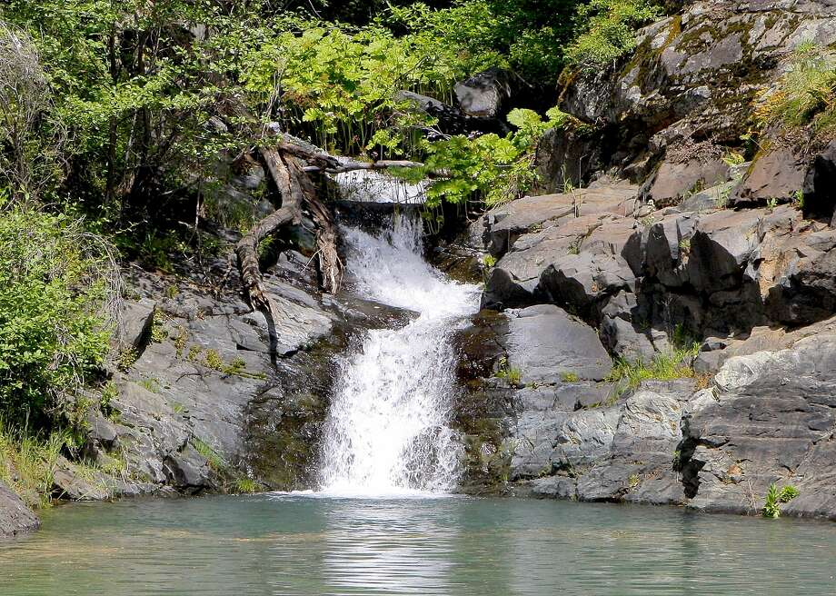 A waterfall at a hidden cove at Shasta Lake, which is now 95 percent full, up 143 feet since December. Photo: Tom Stienstra, Tom Stienstra / The Chronicle