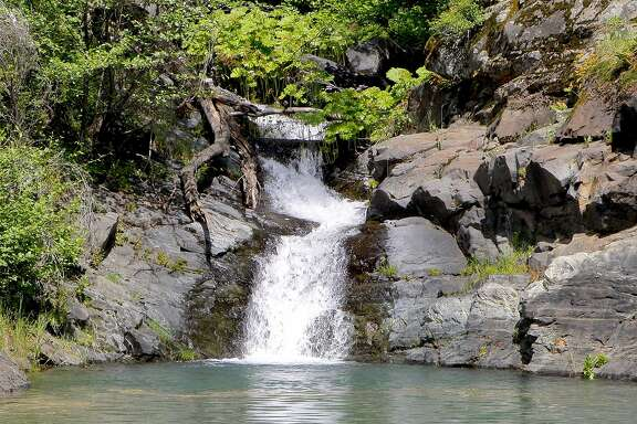 Surprise stairs-step waterfall in hidden cove at Shasta Lake. Water continues to flow in from every creek. Shasta Lake now 92 percent full, up 143 feet since December, expected top out in third week of May.