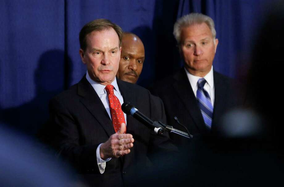 Michigan Attorney General Bill Schuette addresses the media, Wednesday in Flint, Mich. Charges were filed against a pair of state environmental quality employees and a local water treatment supervisor after three months of investigation. Photo: Carlos Osorio, STF