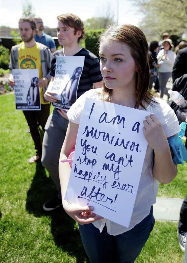 Katie Townsley and other demonstrators at Brigham Young University on Wednesday say school policy discourages women from reporting sexual violence. Photo: Rick Bowmer, STF