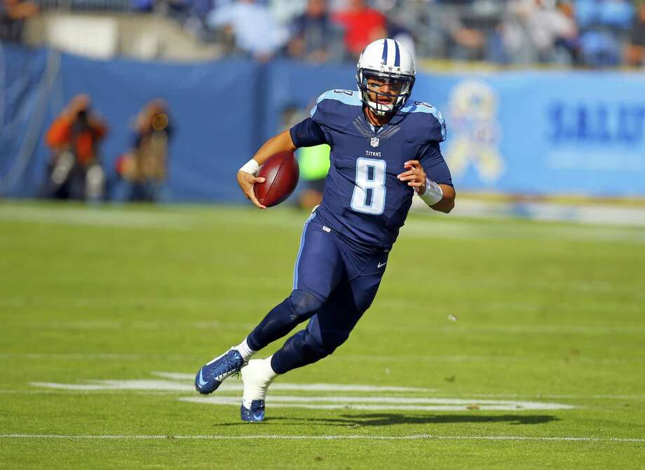 By drafting Marcus Mariota last year, the Titans were in position to trade the No. 1 overall selection to the Rams for a bounty of extra picks. Photo: Jeff Haynes, FRE / FR171008 AP