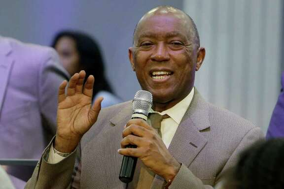 Mayor Sylvester Turner talks with people during an informational meeting about the flood held at Harvest Time Church, 17770 Imperial Valley Dr., Wednesday, April 20, 2016, in Houston.
