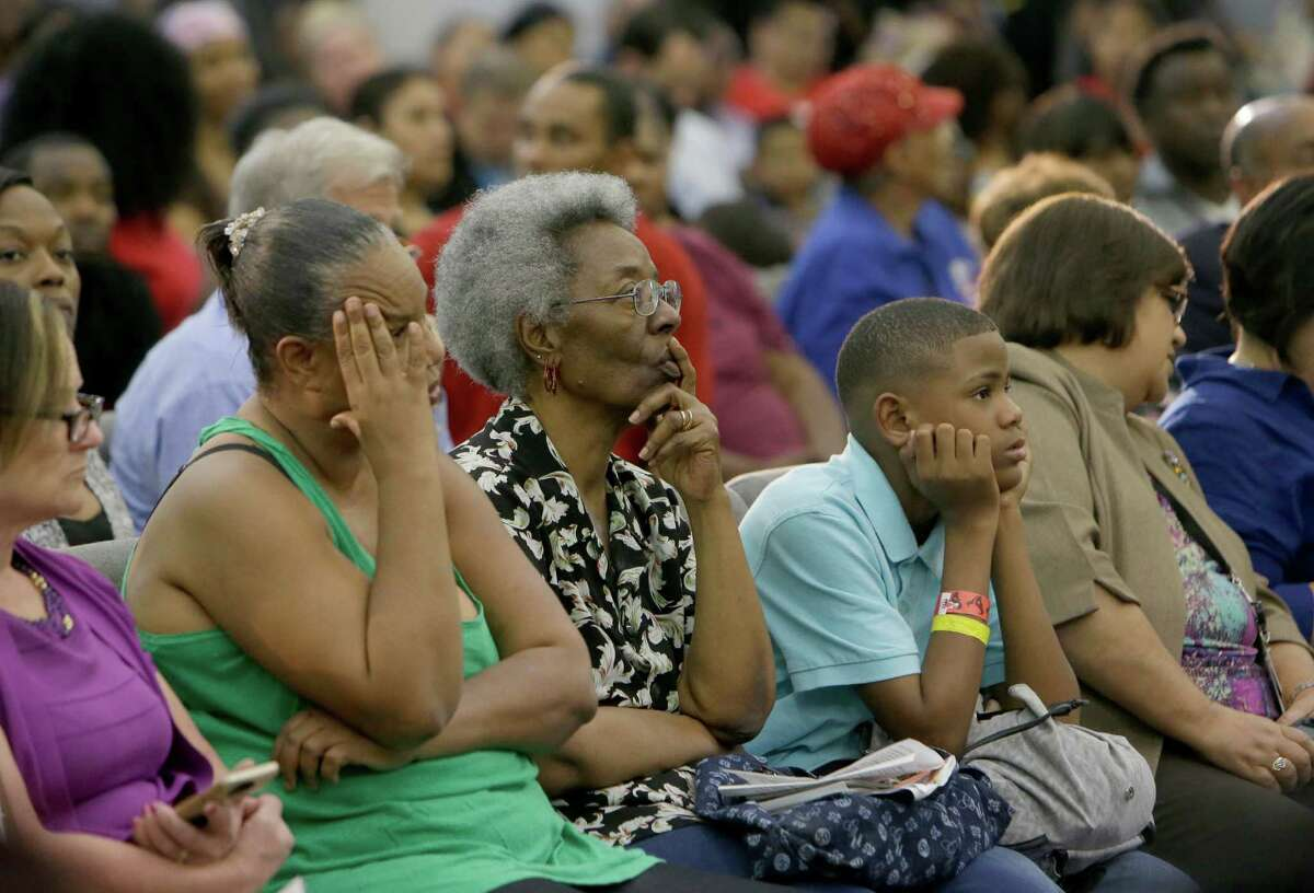 People listen during an informational meeting about the flood held by Mayor Sylvester Turner at Harvest Time Church, 17770 Imperial Valley Dr., Wednesday, April 20, 2016, in Houston.
