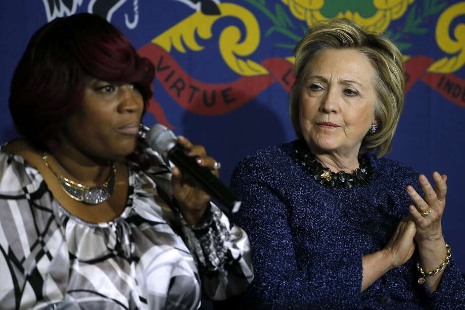 Hillary Clinton, Democratic front-runner, listens to Tanya Brown Dickerson at a stop in Philadelphia. Photo: Matt Rourke, Associated Press