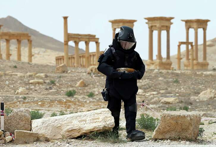 A Russian serviceman on April 8 checks for mines in the Palmyra ancient ruins, Syria. Russian combat engineers arrived in Syria on a mission to clear mines in the ancient town of Palmyra, which has been recaptured from Islamic State militants in an offensive that has proven Russia's military might in Syria despite a drawdown of its warplanes. (Russian Defense Ministry Press Service Photo via AP)