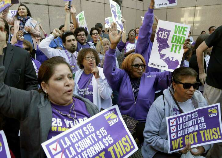 Workers rally outside the Ronald Reagan State Building in Los Angeles April 4 after California Gov. Jerry Brown signed a bill creating the highest statewide minimum wage at $15 an hour by 2022. (AP Photo/Nick Ut)