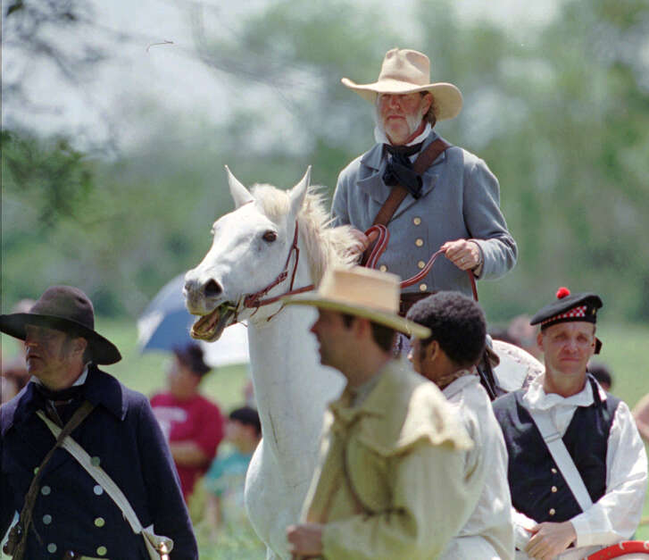 An actor portraying General Sam Houston rides with his Texas troops during a reenactment of the Battle of San Jacinto. (AP file photo)