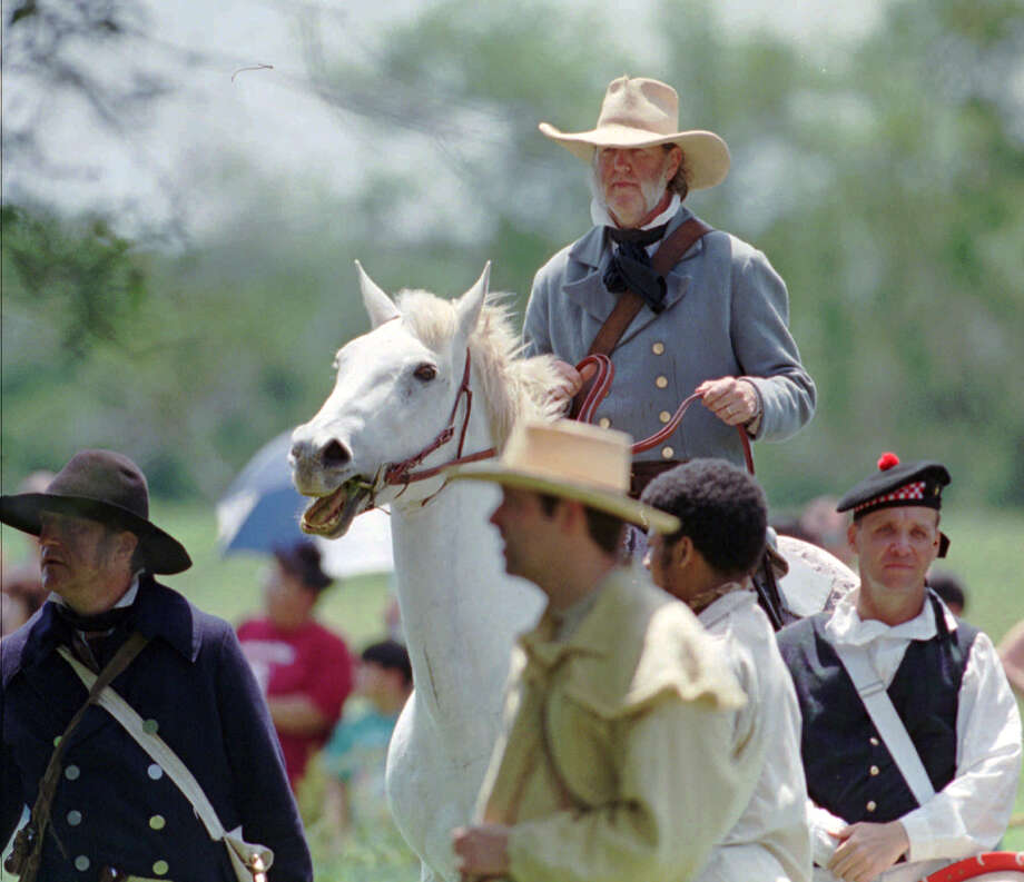 An actor portraying General Sam Houston rides with his Texas troops during a reenactment of the Battle of San Jacinto. (AP file photo) Photo: TIM JOHNSON, STR / AP