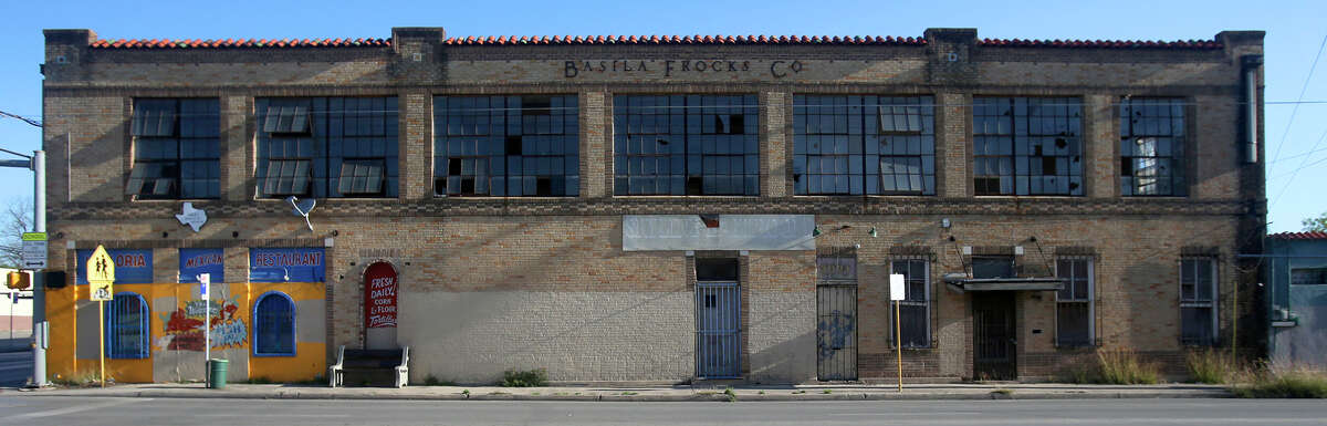 This is the 1929 Basila Frocks Building Friday March 25, 2016 at the northeast corner of Zarzamora and Martin streets. The building is threatened with potential demolition for development of a Dollar General store. The building, with a daylight factory design and Italianate and Mission Revival influences, housed the upper-floor factory of the Basila Frocks Co., founded by a Syrian refugee couple and a pioneer in production of ready-to-wear dresses for women.
