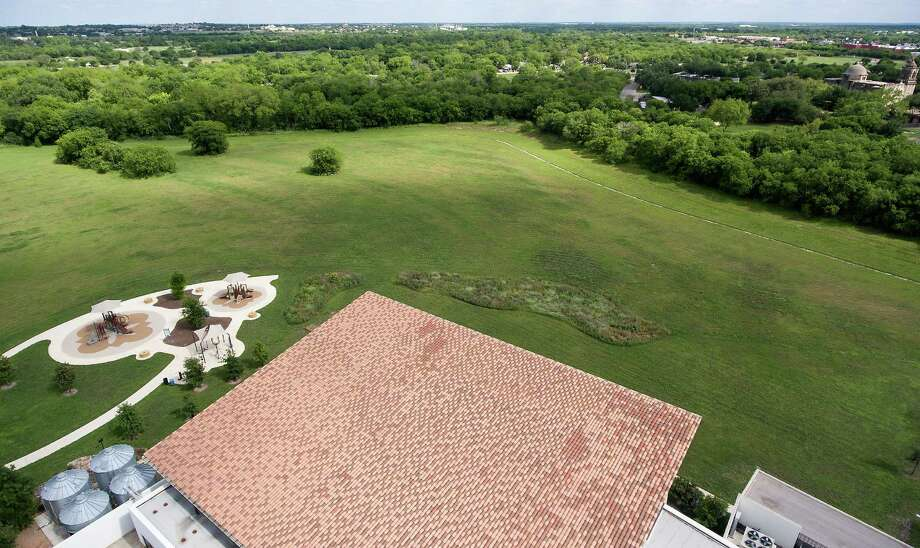 Land behind the Mission Branch Library, seen in an aerial picture taken Wednesday with a remote control quadcopter, is being proposed for YMCA's first sports center on the South Side. Photo: William Luther /San Antonio Express-News / © 2016 San Antonio Express-News