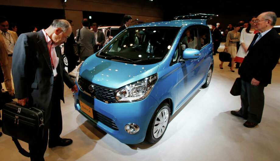 "FILE - In this June 6, 2013, file photo, visitors check Nissan's compact car ""DAYZ"" after a press conference in Tokyo. Mitsubishi Motors Corp., the Japanese automaker tarnished by a massive recall cover-up 15 years ago, owned up to another scandal Wednesday, April 20, 2016, saying employees had intentionally falsified fuel mileage data for several vehicle models. The inaccurate tests by the Tokyo-based automaker involved 157,000 of its own-brand eK wagon and eK Space light passenger cars, and 468,000 Dayz and Dayz Roox vehicles produced for Nissan Motor Co. The models are all so-called ""minicars"" with tiny engines whose main attraction is generally great mileage. They were produced from March 2013. (AP Photo/Koji Sasahara, File) ORG XMIT: TKTT101 Photo: Koji Sasahara / Copyright 2016 The Associated Press. All rights reserved. This m"