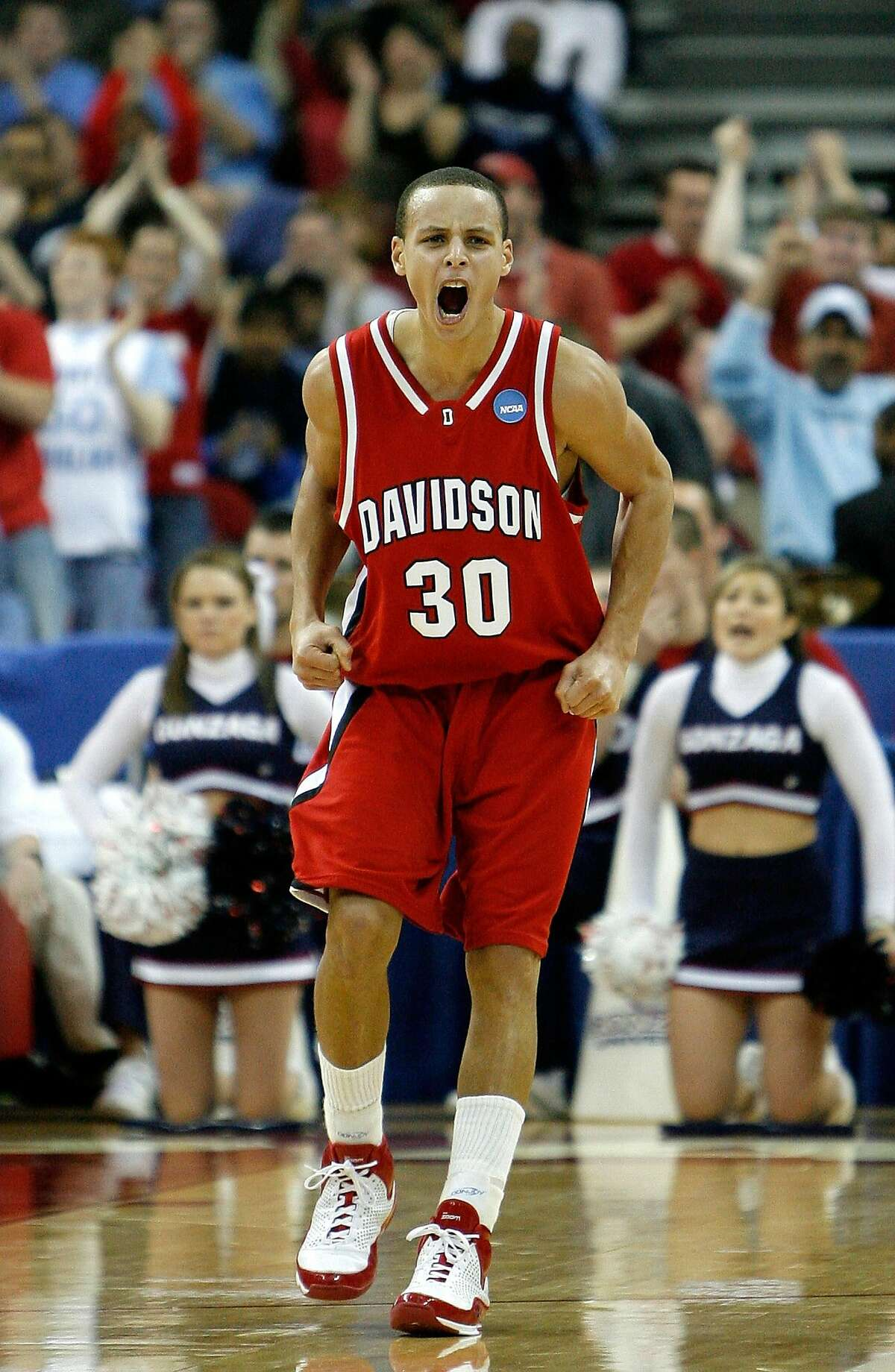 RALEIGH, NC - MARCH 21: Stephen Curry #30 of the Davidson Wildcats celebrates after making a basket against the Gonzaga Bulldogs during the 1st round of the 2008 NCAA Men's Basketball Tournament on March 21, 2008 at RBC Center in Raleigh, North Carolina. (Photo by Streeter Lecka/Getty Images)